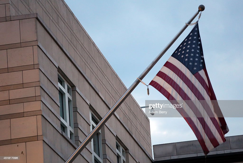 A surveillance camera hangs on the embassy of the United States of America on July 7 2014 in Berlin Germany A German employee of his country's...