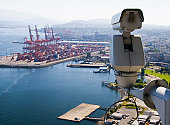 Surveillance Camera is watching  operations in the port.