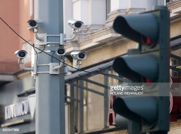 Surveillance cameras are fixed on a pole in the Marxloh district of Duisburg western Germany on December 21 2016 After a truck ploughed through a...