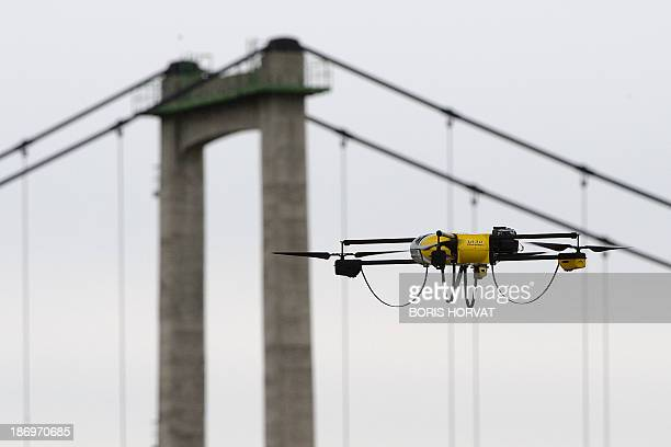 A surveillance drone is used for the benefit of stateowned French rail company SNCF on November 5 2013 2013 near the Roquemaure viaduct in Orange...