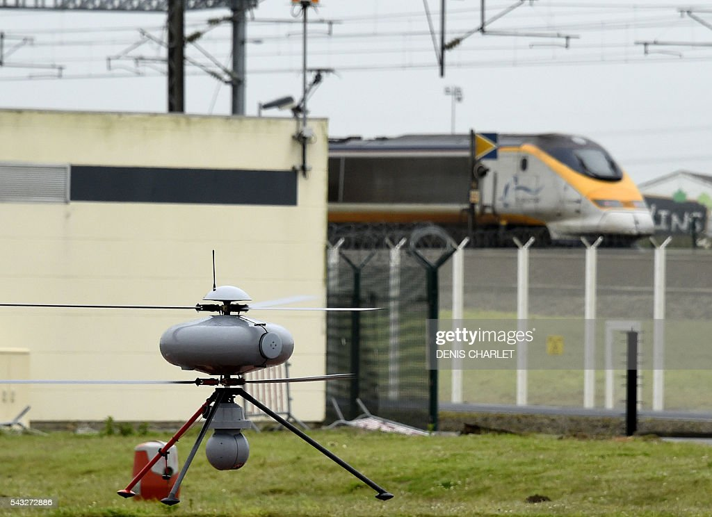 A surveillance drone (or UAV for unmanned aerial vehicle) takes off to monitor the Channel Tunnel on June 27, 2016 in Coquelles, northern France. The Eurotunnel Group acquired two military drones with a thermal infra-red camera for monitoring the 650 hectares area against potential instrusions of migrants who try to reach Britain by the Channel Tunnel. / AFP / DENIS