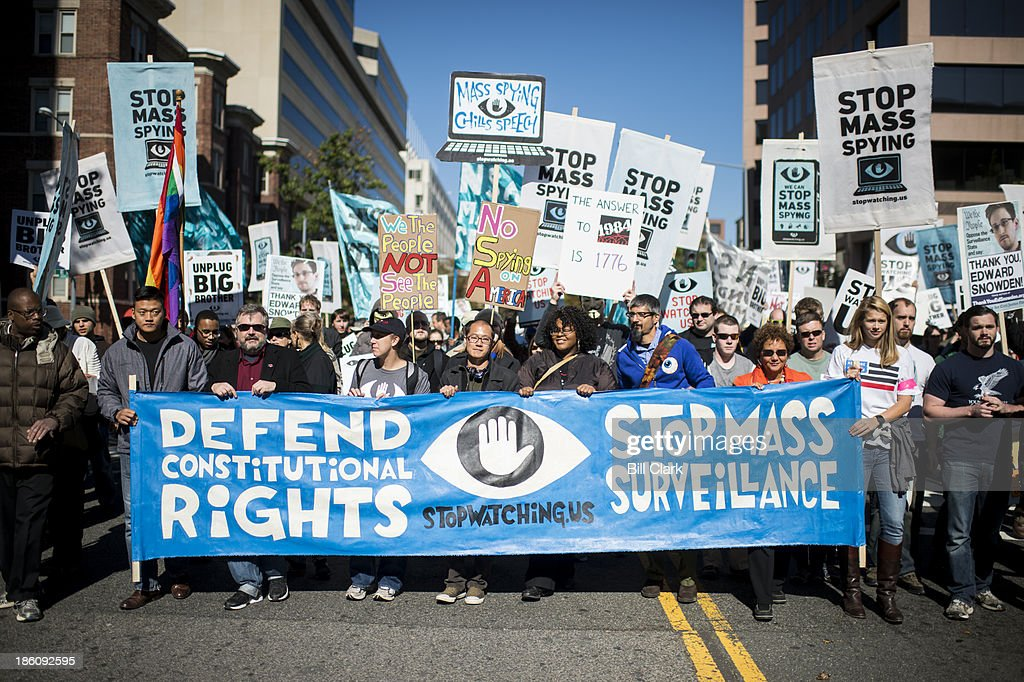 NSA surveillance protesters organized by the 'Stop Watching Us' coalition march from Union Station to the US Capitol on Saturday Oct 26 to voice...