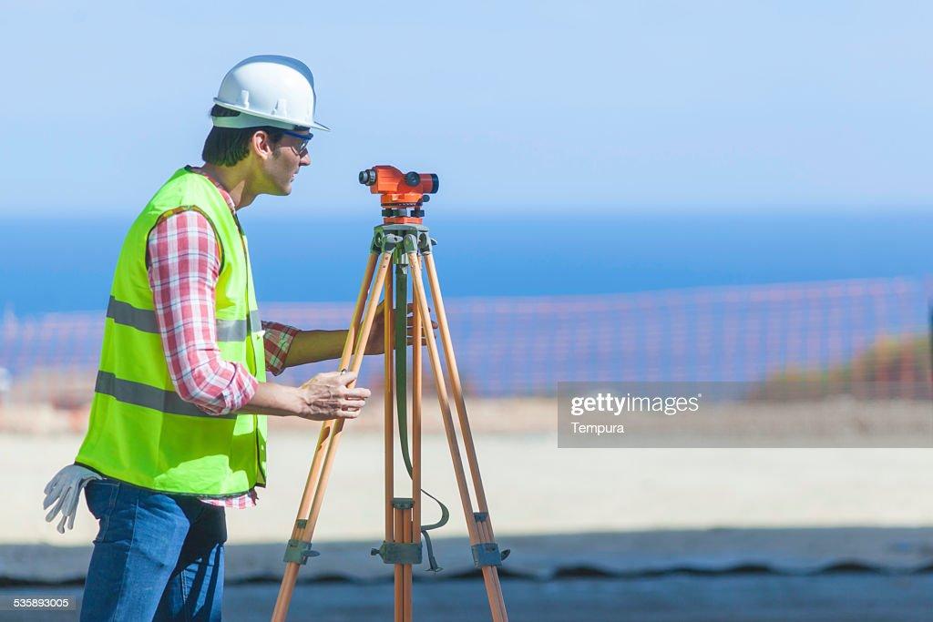 Surveying on the construction site. : Bildbanksbilder