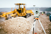 Surveyor equipment GPS system or theodolite outdoors at highway construction site. Surveyor engineering with total station