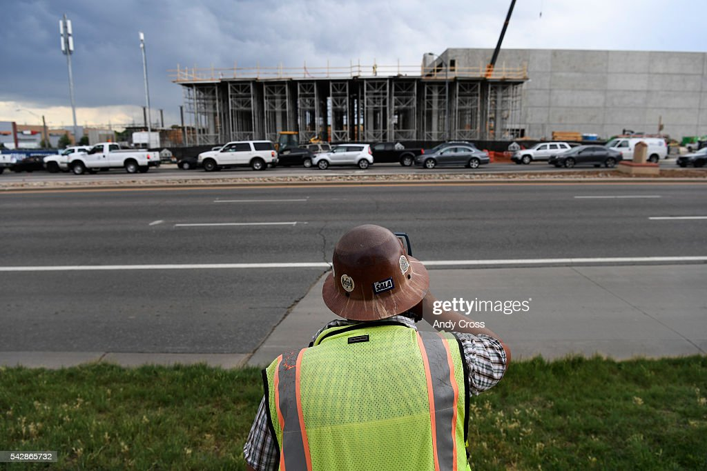 Surveyor Mario Reyes works on The Forum at Fitzsimons construction site near Colfax Ave and 225 June 24, 2016.