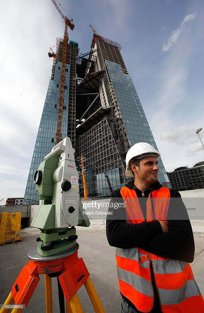 A surveyor stands past the construction site of the new European Central Bank (ECB) headquarters during a media tour on September 20, 2012 in Frankfurt, Germany. The new, twin-tower headquarters is scheduled for completion by 2014.