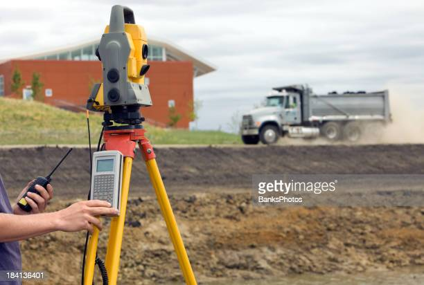 Surveyor using Total Station with Data Collector