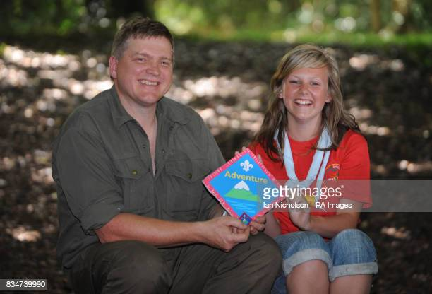 Survival expert Ray Mears poses with Explorer Scout Chloe Marriott from East Wickham Welling at Camp Downe in Kent after being awarded his Outdoor...