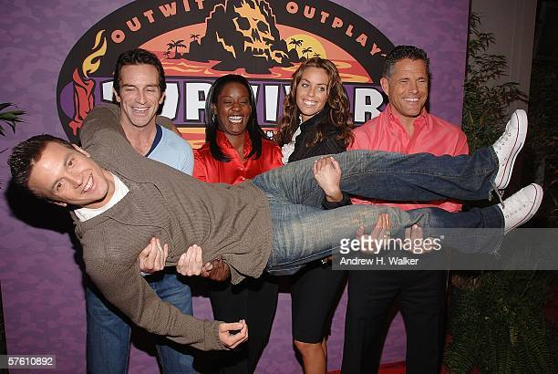 Survivor Castaway winner Aras Baskauskas is lifted by host Jeff Probst and finalists Cirie Fields Danielle DiLorenzo and Terry Deitz at the CBS...