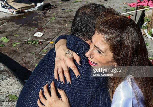 A survivor hugs her friend after an explosion during a peace march in Ankara October 10 2015 Turkey At least 30 people were killed and 130 people...