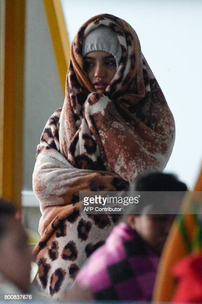 CORRECTION A survivor is clad in a blanket after being rescued from the tourist boat Almirante in the Reservoir of Penol in Guatape municipality in...