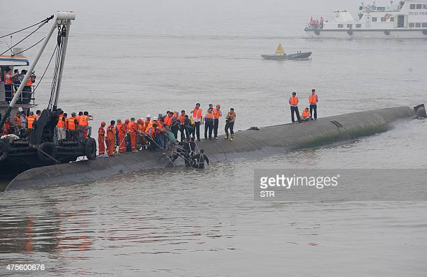 A survivor is rescued by divers from the Dongfangzhixing or 'Eastern Star' vessel which sank in the Yangtze river in Jianli central China's Hubei...