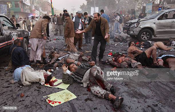 A survivor looks over the dead and wounded immediately after a bomb attack on former Prime Minister Benazir Bhutto December 27 2007 in Rawalpindi...