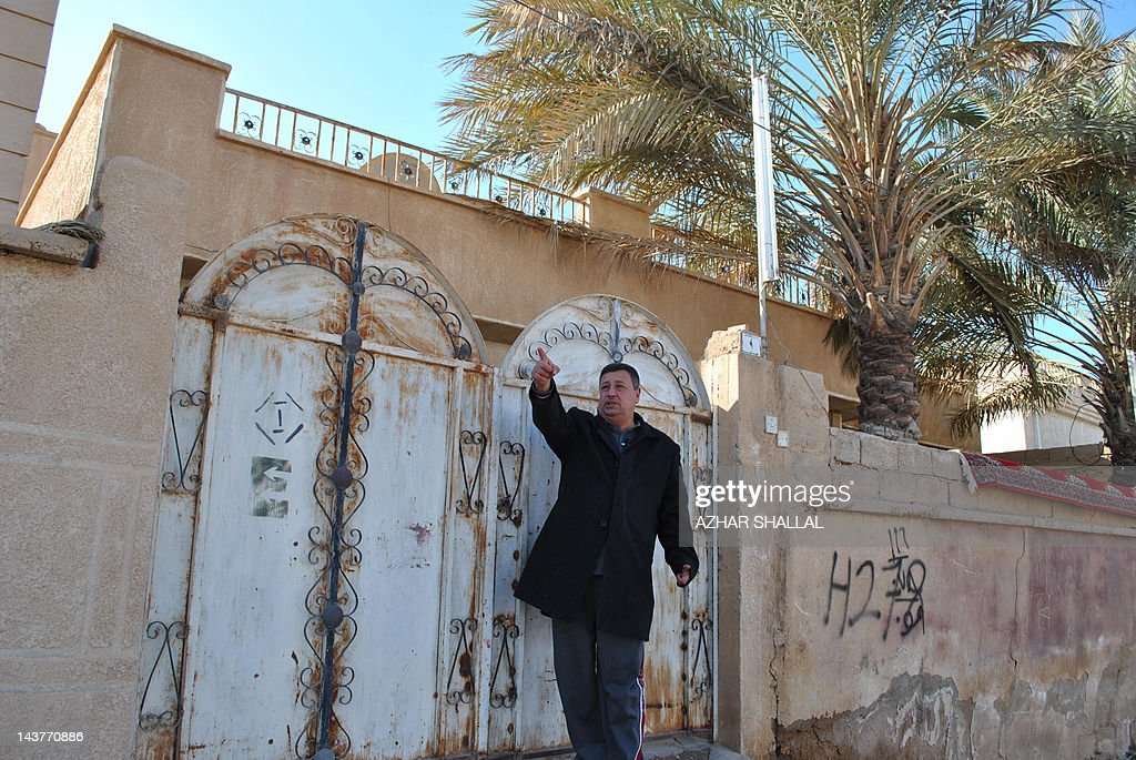 A survivor of a 2005 fatal shooting by US troops in the predominantly Sunni Anbar province in western Iraq, Awous Famih Hussein, tells his story on January 24, 2012 outside his home on the street where much of the violence took place in Haditha, a town of around 80,000 people. The 45-year-old civil servant and father of five, is one of Haditha residents and relatives of those killed by US troops in 2005 who have voiced shock and disgust over the light sentence meted out to a US soldier involved in the massacre.