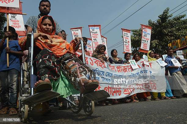 A survivor of Rana Plaza garment factory building collapse Moriyum marches in the street during a demonstration in Savar on the outskirts of Dhaka on...