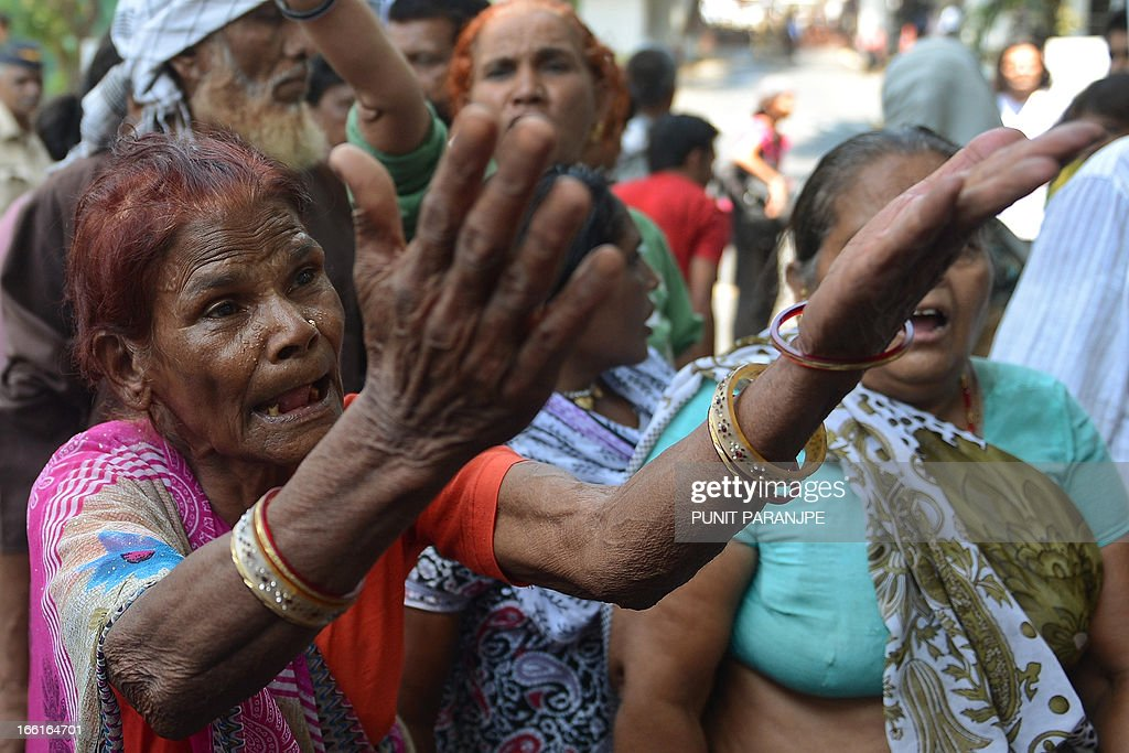 A survivor of the 1984 Bhopal gas tragedy shouts and gestures during a protest outside the office of Dow Chemical International Private Ltd in Mumbai on April 9, 2013. Three thousand seven hundred people died immediately in the world's worst industrial disaster in 1984 when gas leaked from a pesticides plant owned by the US multinational Union Carbide in Bhopal. For decades, survivors have been fighting to have the site cleaned up, but they say the efforts were slowed when Michigan-based Dow Chemical took over Union Carbide in 2001.