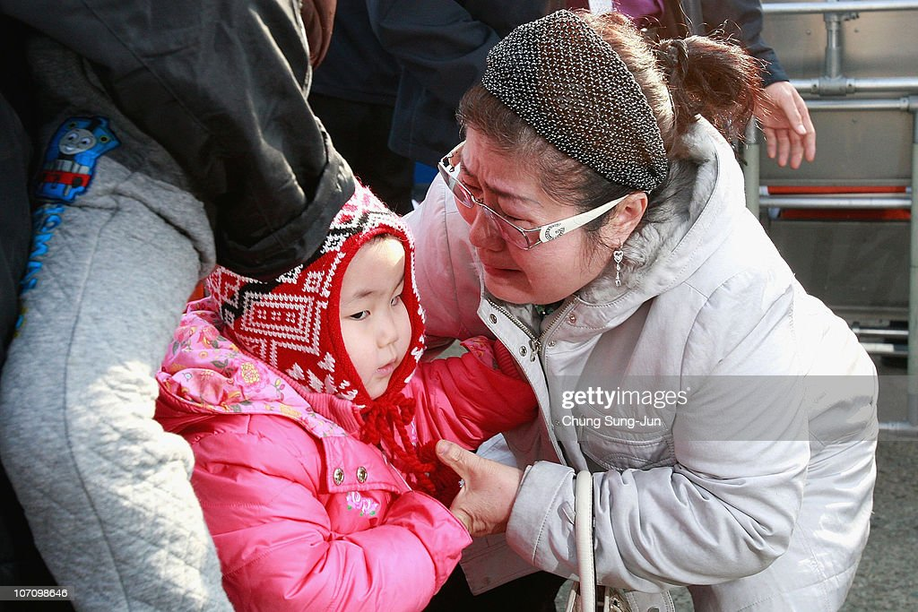 A survivor of the artillery exchange between North and South Korea shows their emotion after arriving at Incheon port from Yeonpyeong Island on...