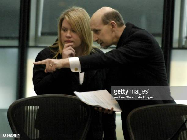 Survivor of the suicide bomb attacks last July 'Kristina' takes direction from Assembly Member Patrick Hulme Cross before giving evidence to the 7...
