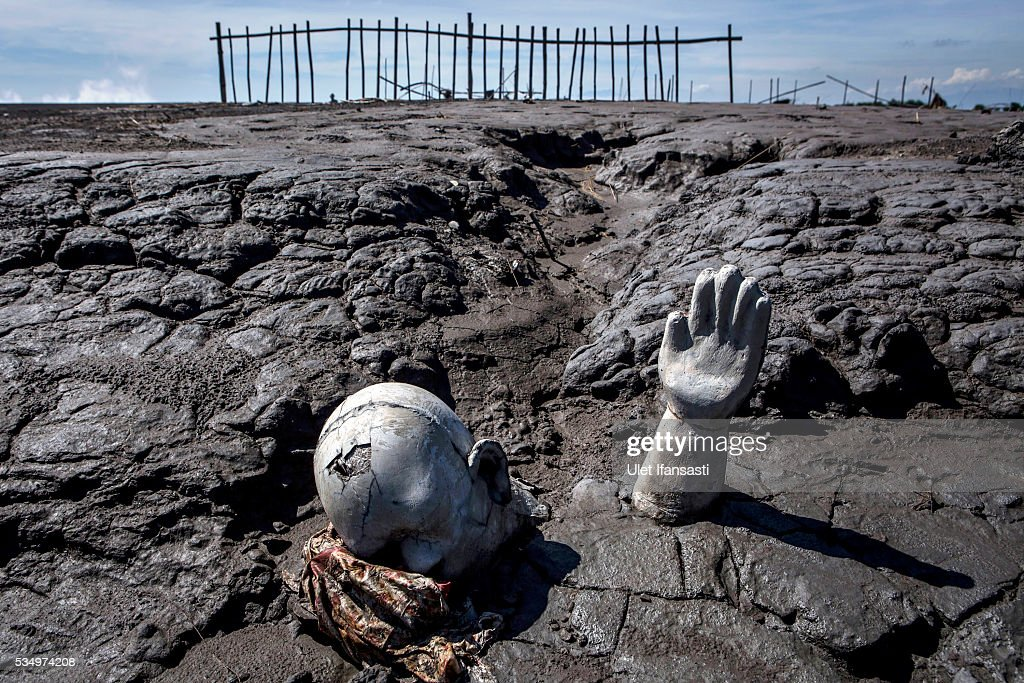 Survivor statues are displayed at mudflow areas to signify the lives of victims on May 27, 2016 in Sidoarjo, East Java, Indonesia. Residents of villages that were damaged by the Sidoarjo mudflow and residents received compensation, after almost ten years, from the Indonesian oil and gas company, PT Lapindo Brantas. The mudflow eruption is suspected to have been triggered by the drilling activities of oil and gas company, though they refute the claims, instead blaming a 6.3 magnitude earthquake that struck a neighboring city two days before the mudflow eruption. The earthquake struck Yogyakarta on May 27th, 2006, a city 150 miles west of a drill site in Sidoarjo, two days before the mudflow eruption. According to reports, twenty lives were lost and nearly 40,000 people displaced, with damages topping $2.7 billion. Ten years since the eruption, the mud geysers continue to spurt daily and high levels of heavy metals have been detected in nearby rivers.