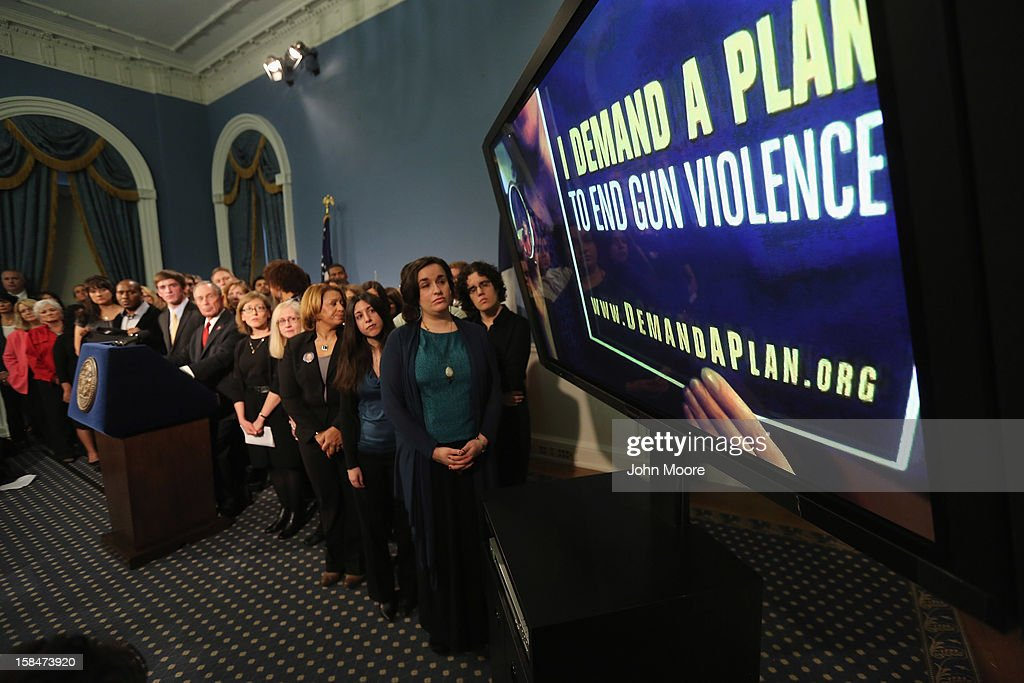 Survivors and family members of gun violence watch a video about gun violence at a press conference with New York City Mayor Michael Bloomberg at City Hall on December 17, 2012 in New York City. Bloomberg, co-chair of Mayors Against Gun Violence presented a series of videos called 'I Demand a Plan' highlighting personal stories representing Americans killed every day by gunfire. The mayor spoke at length condemning last week's mass murder in Newtown, CT, calling for stronger gun-control legislation.
