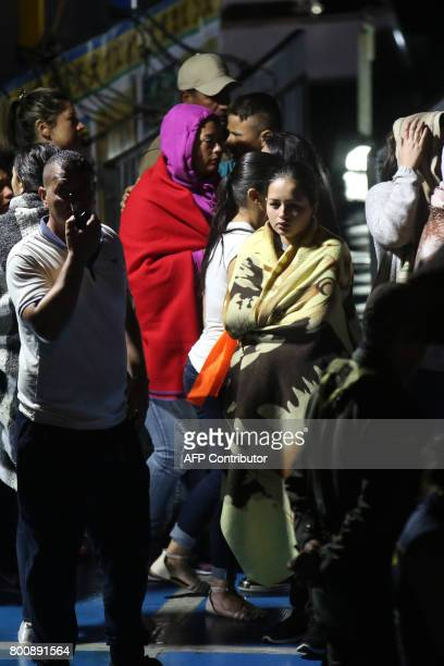 CORRECTION Survivors are clad in blankets after the tourist boat Almirante sank in the Reservoir of Penol in Guatape municipality in Antioquia on...