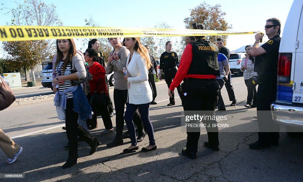 Survivors are evacuated from the scene of a shooting under police and sheriff's escort on December 2 2015 in San Bernadino California One or more...