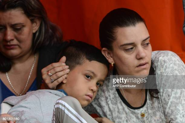 Survivors are pictured after the tourist boat Almirante sank in the Reservoir of Penol in Guatape municipality in Antioquia northwestern Colombia on...