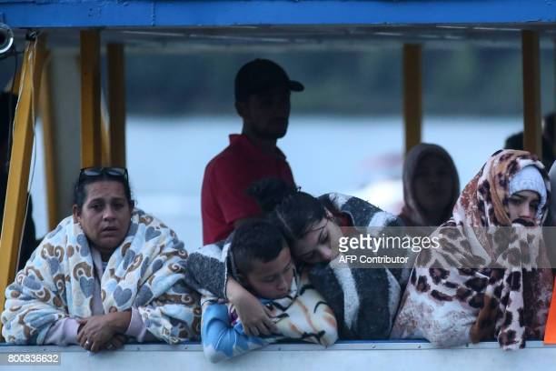 TOPSHOT Survivors are seen after the tourist boat Almirante sank in the Reservoir of Penol in Guatape municipality in Antioquia on June 25 2017 At...