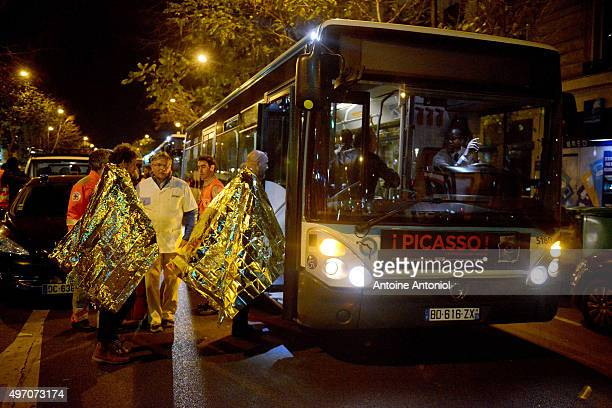 Survivors board a bus after gunfire in the Bataclan concert hall on November 13 2015 in Paris France According to reports over 150 people were killed...