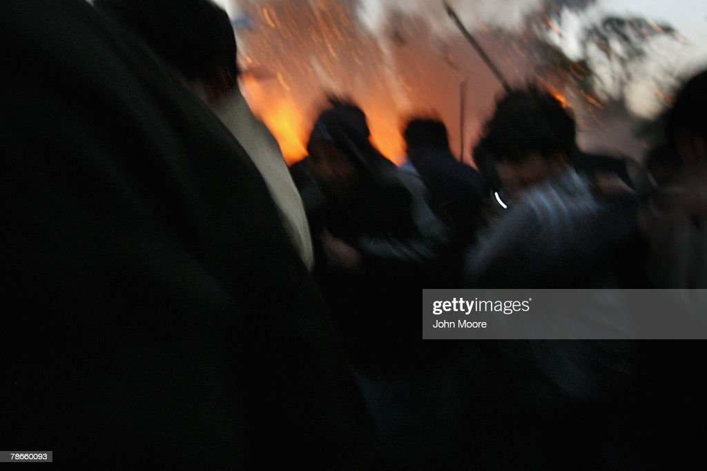 Survivors flee a bomb blast attack on former Prime Minister Benazir Bhutto December 27 2007 following a campaign rally in Rawalpindi Pakistan The...