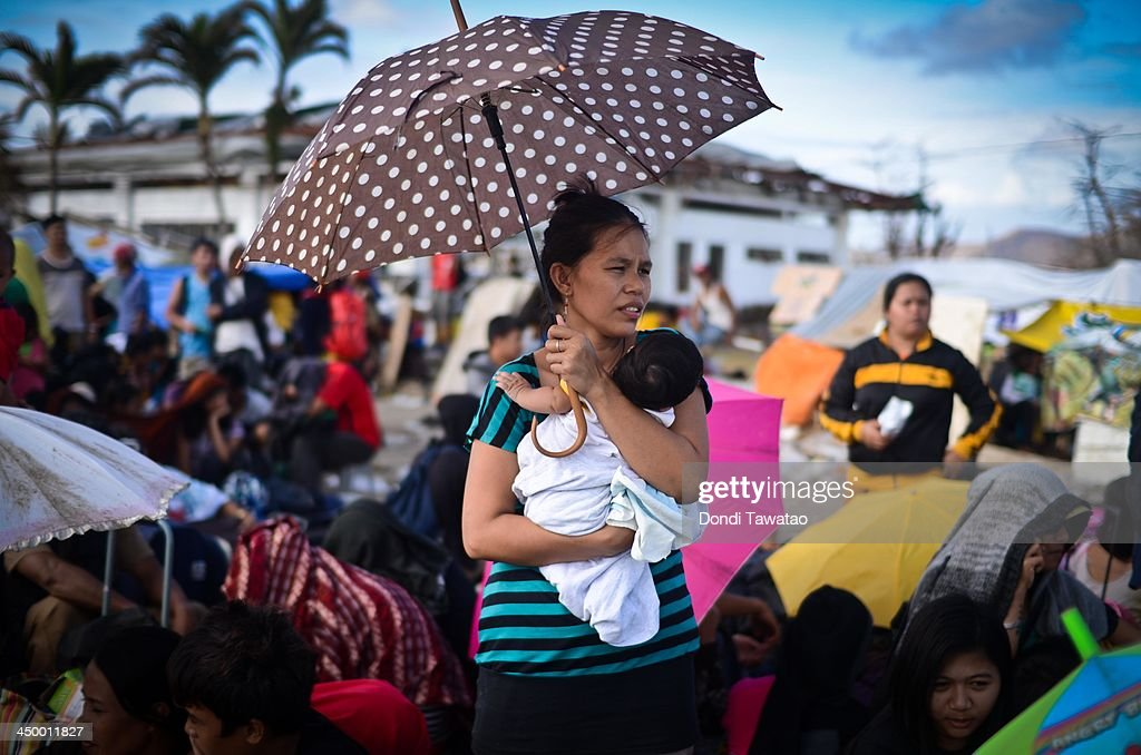 Survivors gather at Tacloban to await transport to neighboring Cebu island province on November 16 2013 in Leyte Philippines Typhoon Haiyan which...