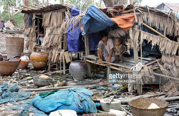 Survivors of cyclone Nargis are seen in Labutta in the Irrawaddy Delta on June 14 2008 New guidelines recently adopted by Myanmar's ruling generals...