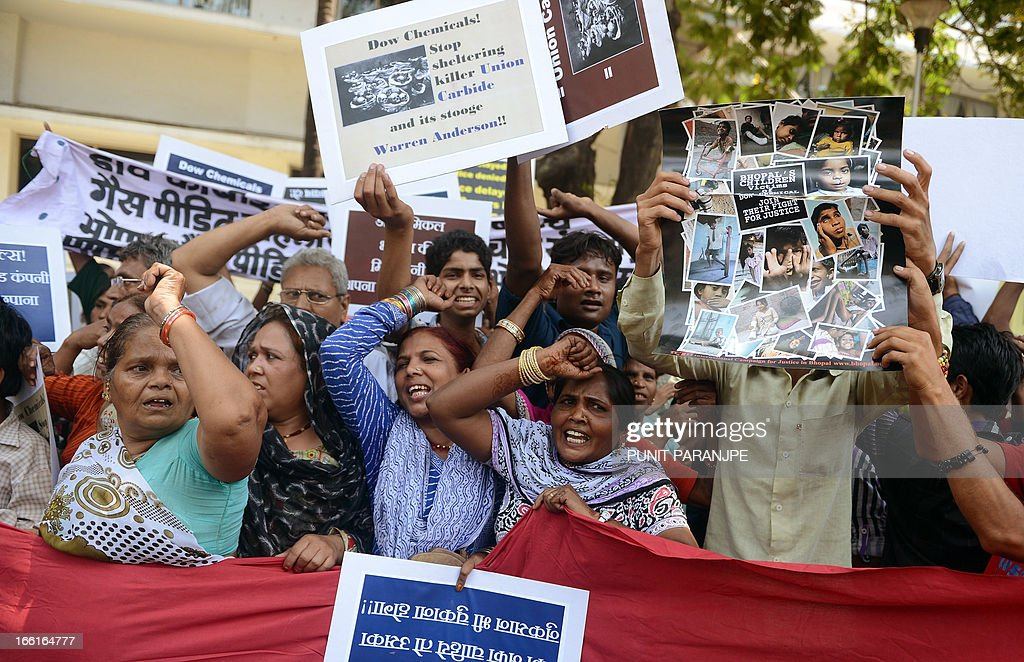 Survivors of the 1984 Bhopal gas tragedy and other demonstrators shout slogans during a protest outside the office of Dow Chemical International Private Ltd in Mumbai on April 9, 2013. Three thousand seven hundred people died immediately in the world's worst industrial disaster in 1984 when gas leaked from a pesticides plant owned by the US multinational Union Carbide in Bhopal. For decades, survivors have been fighting to have the site cleaned up, but they say the efforts were slowed when Michigan-based Dow Chemical took over Union Carbide in 2001. AFP PHOTO/ PUNIT PARANJPE