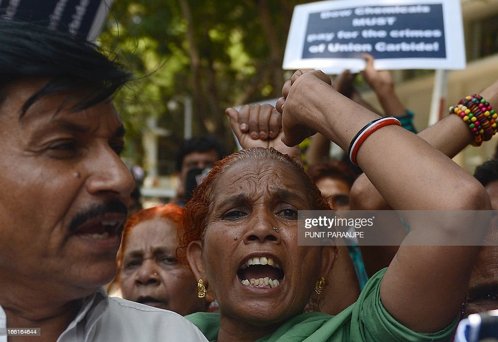 Survivors of the 1984 Bhopal Gas Tragedy shout slogans during a protest outside the office of Dow Chemical International Private Ltd in Mumbai on April 9, 2013. Three thousand seven hundred people died immediately in the world's worst industrial disaster in 1984 when gas leaked from a pesticides plant owned by the US multinational Union Carbide in Bhopal. For decades, survivors have been fighting to have the site cleaned up, but they say the efforts were slowed when Michigan-based Dow Chemical took over Union Carbide in 2001. AFP PHOTO/ PUNIT PARANJPE