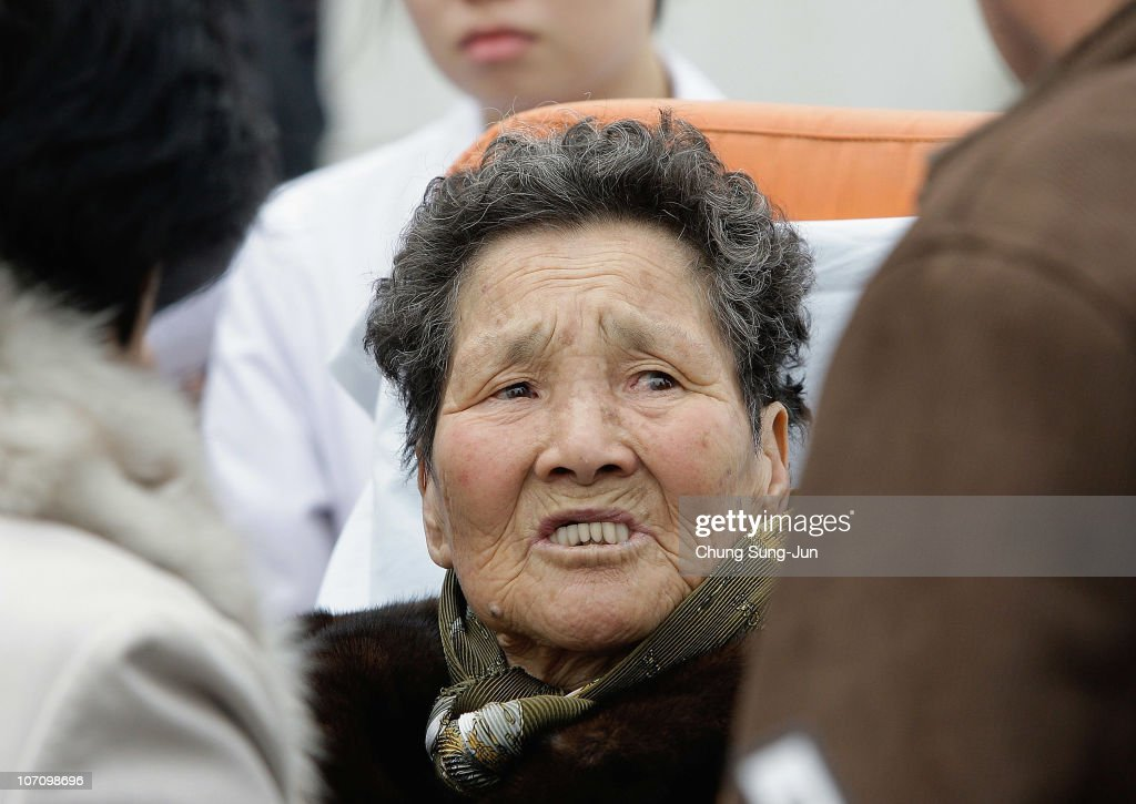 Survivors of the artillery exchange between North and South Korea arrive at Incheon port from Yeonpyeong Island on November 24 2010 in Incheon South...