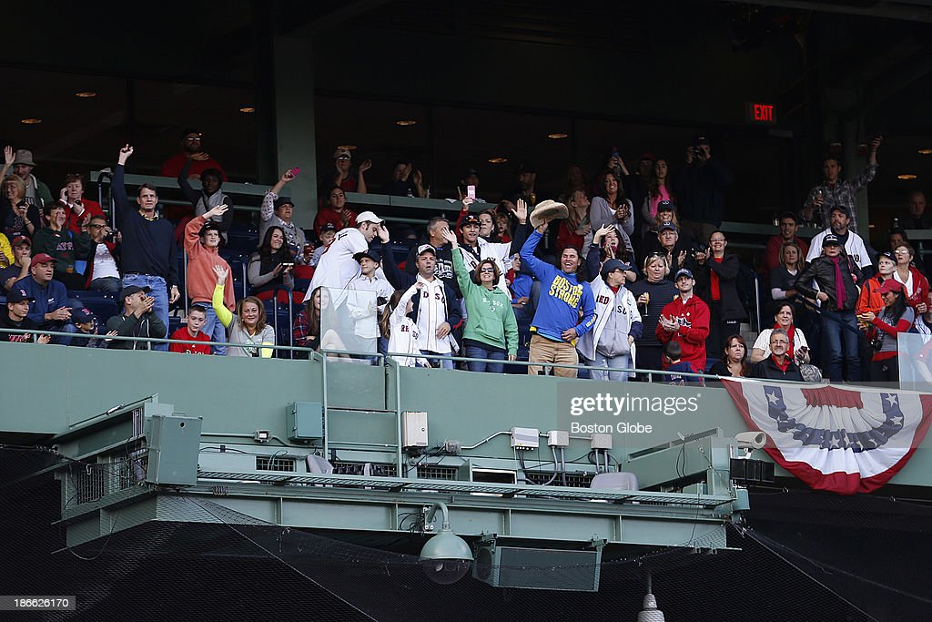 Survivors of the Boston Marathon bombing cheered in the stands after they were acknowledged. The Red Sox Rolling Rally started at Fenway Park and paraded around Boston after the Boston Red Sox won the 2013 World Series, on Saturday, Nov. 2, 2013.