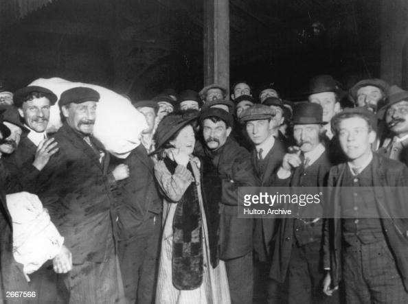 Survivors of the Titanic disaster are greeted by their relatives upon their safe return to Southampton