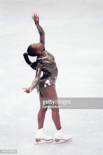 Surya Bonaly of France performs in the fall Skate America figure skating Ladies' Singles competition held in 1991 at the OaklandAlameda County Arena...