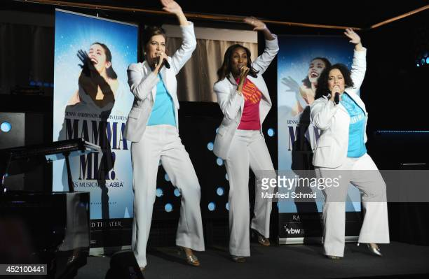 Susa Meyer Ana Milva Gomes and Jacqueline Braun perform on stage during the 'Mamma Mia' musical press conference at Volksgarten on November 26 2013...