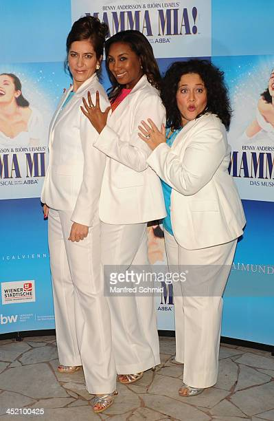 Susa Meyer Ana Milva Gomes and Jacqueline Braun pose for a photograph during the 'Mamma Mia' musical press conference at Volksgarten on November 26...