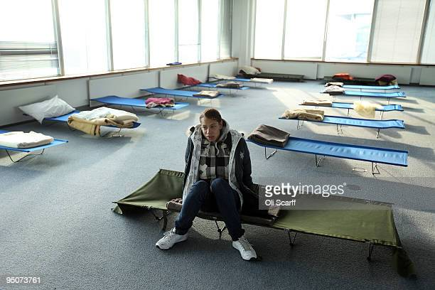 Susan a homeless woman from London rests on a campbed in the dormitory of a Christmas homeless shelter set up by the charity 'Crisis' on December 23...