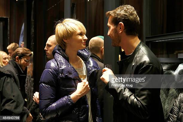 Susan Atwell and Joerg Oppermann attend the Moncler Boutique Opening on December 10 2013 in Hamburg Germany