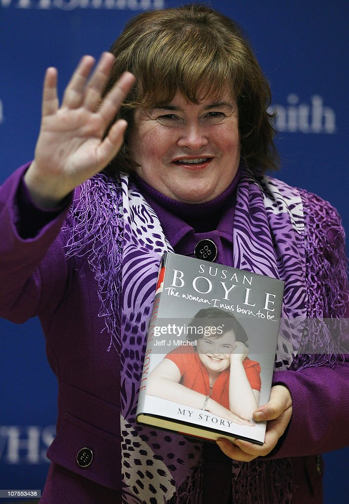 Susan Boyle holds a copy of her book 'The Woman I Was Born To Be' at the St Enoch Centre on December 13 2010 in Glasgow Scotland The autobiography...