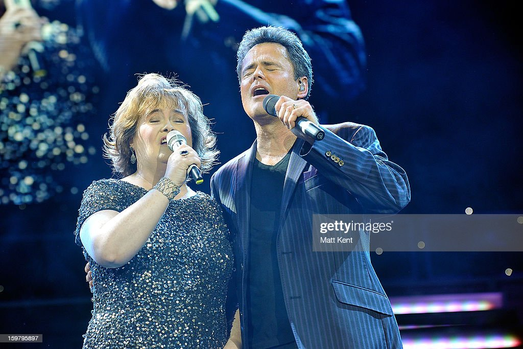 Susan Boyle performs with Donny Osmond during the Donny and Marie Osmond concert at the 02 Arena on January 20 2013 in London England