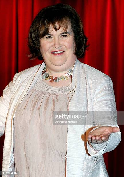 Susan Boyle poses for photos alongside her new wax figure at the official launch of the new Madame Tussauds venue in Blackpool on April 19 2011 in...