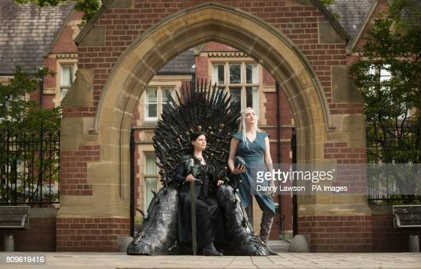 Susan Broadbent dressed as Sansa Stark and Georgina Lambert dressed as Daenerys Targaryen with a replica of the throne made famous by TVacircs Game...