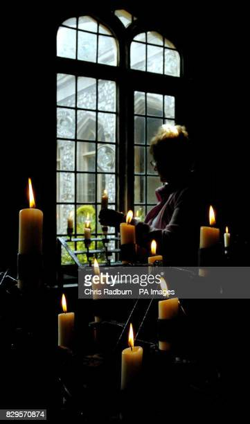 Susan Bundy from Stevenage lights a candle for the Pope in the Chapel of the Holy Ghost