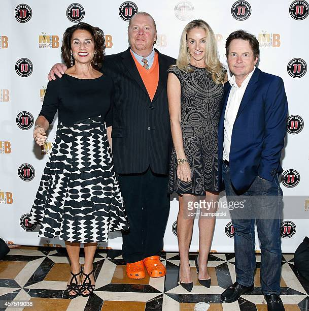 Susan Cahn Mario Batali Tracy Pollan and Michael J Fox attend 3rd Annual Mario Batali Foundation Benefit Dinner at Del Posto Ristorante on October 19...
