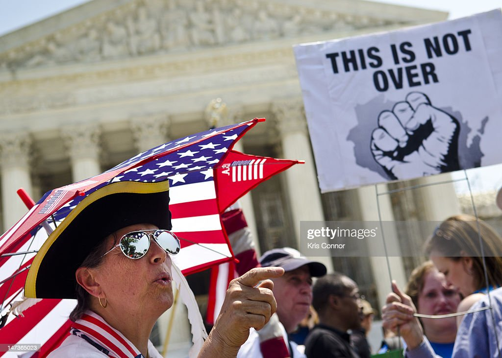 Susan Clark argues with a another protester about the Affordable Healthcare Act outside the U.S. Supreme Court on June 28, 2012 in Washington, DC. The Court found the law to be constitutional and did not strike down any part of it.