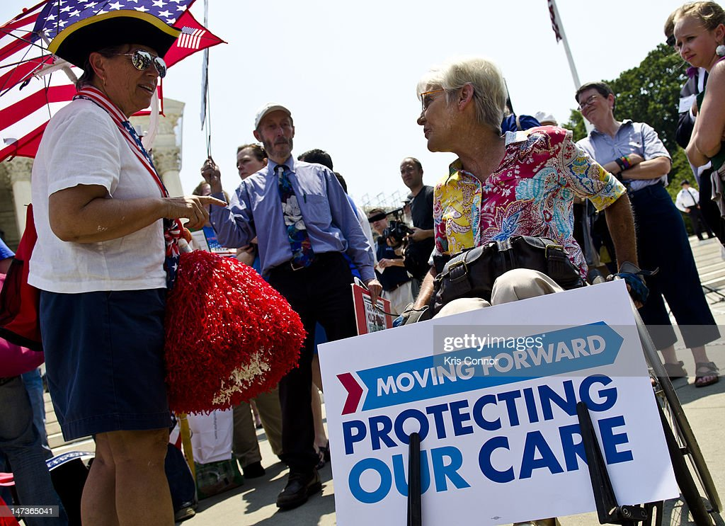 Susan Clark (L) argues with a another protester about the Affordable Healthcare Act outside the U.S. Supreme Court on June 28, 2012 in Washington, DC. The Court found the law to be constitutional and did not strike down any part of it.